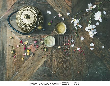 Traditional Asian Tea Ceremony Arrangement. Flat-lay Of Iron Teapot, Cups, Dried Rose Buds And Bloom