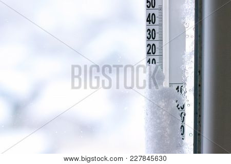 Thermometer On Window In Snow Shows Temperature On Street