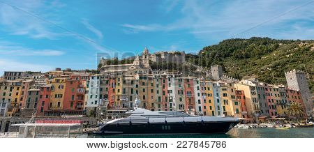 Luxurious Yacht In The Port Of Porto Venere Or Portovenere (unesco World Heritage Site), Seen From T
