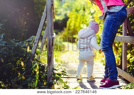 Young Woman With A Mother On A Walk, Sunny Bright Weather, Raising And Caring For Children