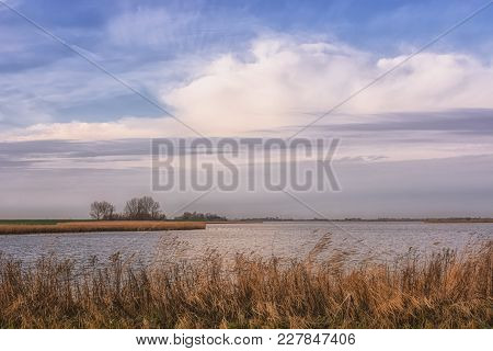 Typical Flat Dutch Polder With Its Ditches And Lakes