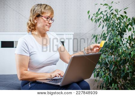 Old People And Modern Technology Concept. Portrait Of A 50s Mature Woman Hand Holding Credit Card, U