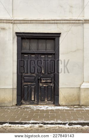 Black Wooden Doors Of Old Historical House In Winter