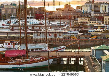 Oslo, Norway: Apr 25 2017 - Different Ships In The Port Near The Akershus Castle At The Evening.