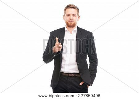 Portrait Of Young Caucasian Businessman In Black Suit And White Shirt Posing On White Background