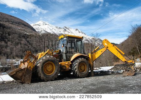 A Yellow Earth Mover In The Mountain