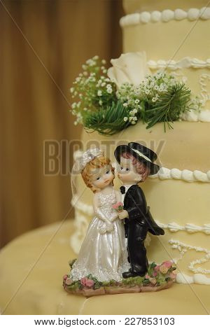 Wedding Cake With The Decoration  Of Bride And Groom Closeup