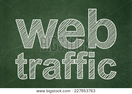 Web Design Concept: Text Web Traffic On Green Chalkboard Background
