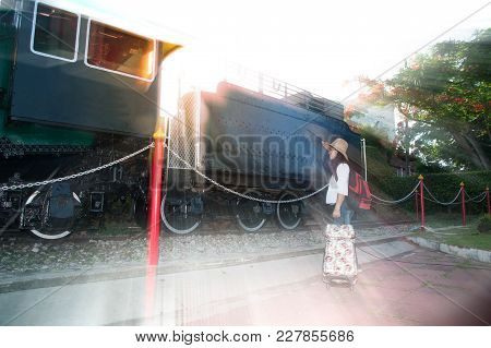 Pretty Asian Women Backpacker Standing And Posing Joyful At Steam Locomotive.
