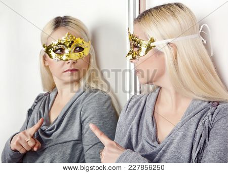 Woman In Carnival Mask Pointing Finger At His Reflection In The Mirror.