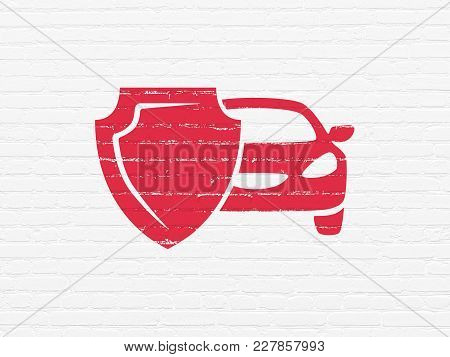 Insurance Concept: Painted Red Car And Shield Icon On White Brick Wall Background