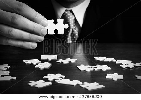 A Businessman With A Jigsaw Puzzle Game.