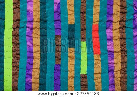 Textile Background - Stitched Patchwork Scarf From Many Vertical Narrow Silk Strips