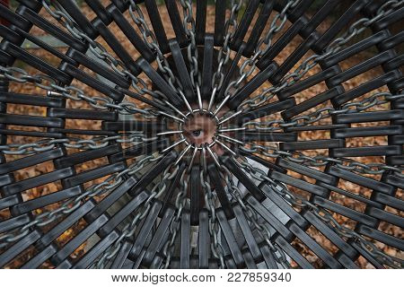An Eye Of A Young Person Staring At The Viewer Through A Symmetrical Geometric Pattern Of The Bottom