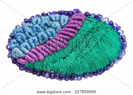 Hand Made Knitted Brooch Isolated On White Background