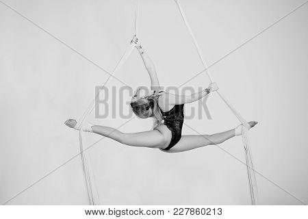 Flying Attractive Acrobatics On Silk Tissue. Perfect Acrobatic Mastership