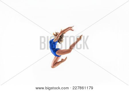 The Portrait Of Beautiful Young Brunette Woman Gymnast Training Calilisthenics Exercise With Acrobat