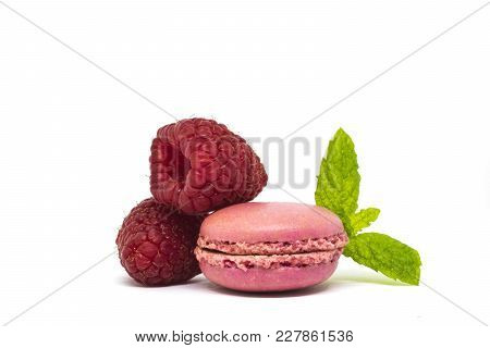 Delicious Pink French Macaroons On White Background With Fresh Raspberry And Mint Leaves.