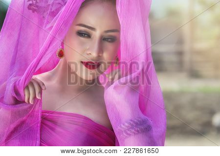 Beautiful Thai Woman Wearing Traditional Thai Dress With Silk Fabric Cover Her Head