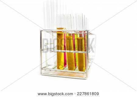 Stand With Test Tubes Isolated On White. Several Chemical Solution In Flask.