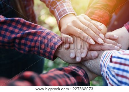 Group Holding Together As Different  People Putting Their Hands Connected Linked Together And Commun