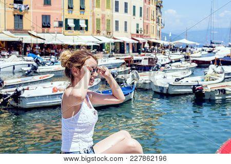 Woman Portrait In Portofino, Italy. Beautiful Day At The Port View