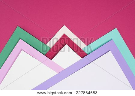 View Of Colored Different Triangles Isolated On Burgundy