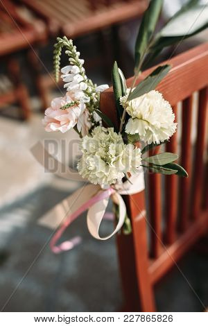 Chair Decorated With Flowers On The Wedding Ceremony
