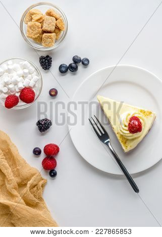 Top View Of Piece Of Appetizing Dessert With Berries On White Surface