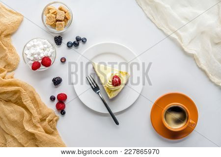 Top View Of Piece Of Yummy Cake With Berries On White Tabletop