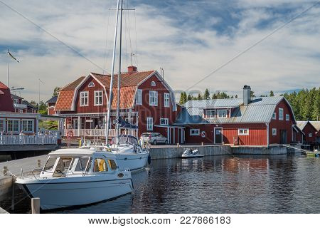 Sweden - August 11, 2017: View At The Coastline In The Swedish Village On A Lake.