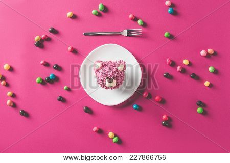 Top View Of Dessert In Shape Of Bear Head On Plate On Pink Surface