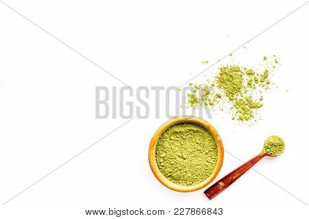 Powdered Matcha Green Tea In Bowl And Scattered On White Background Top View.