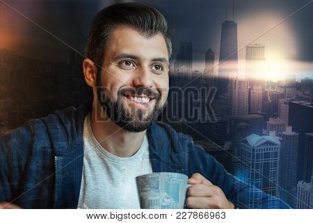 Smiling Person. Positive Emotional Bearded Man Feeling Happy While Sitting With A Cup Of Tea And Loo