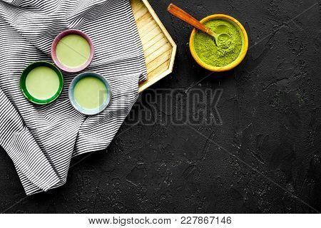 Japanise Tea Ceremony With Matcha Tea. Bowl With Powder And Cups With Beverage On Tablecloth Black B
