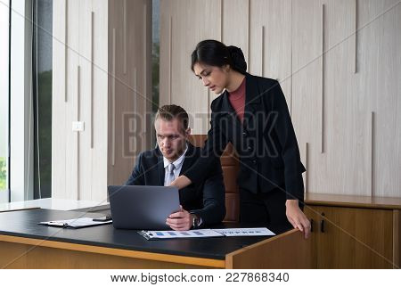 Manager And Secretary Are Discussing Working In Modren Office.