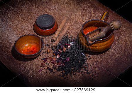 Closeup On Flavored Tea Mix On Wood