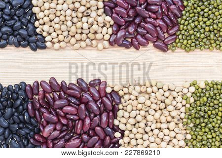 A Pile Of Many Types Of Beans Such As Mung Bean, Soybean, Black Bean, And Red Bean Divided Into Two