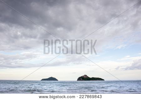 Landscape Of Islands In The Sea With Cloudy Sky.