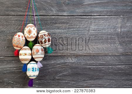 Happy Easter Card. Colorful Shiny Easter Eggs On Gray Wooden Table Background. Copy Space For Text