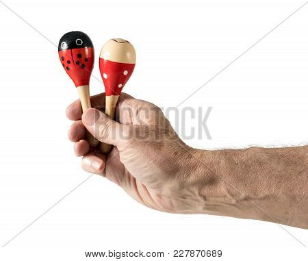 Cinco De Mayo Cutout With Senior Caucasian Arm And Hand Holding Two Small Maracas And Isolated Again
