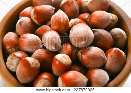 Hazelnut Nuts In A Wooden Bowl On A White Wooden Table. Superfood