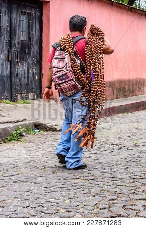 Antigua, Guatemala -  April 13, 2017: Selling Crucifixes On Holy Thursday In Town With Most Famous H