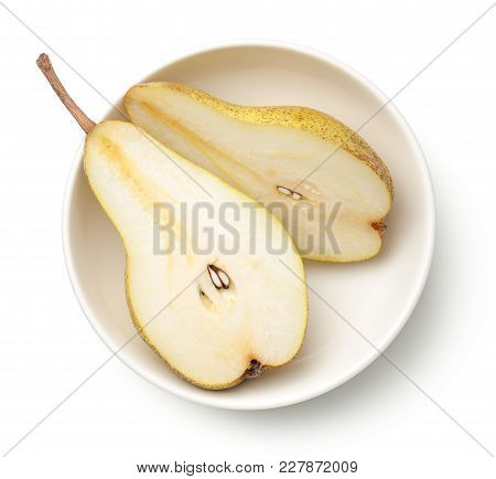 Pear In Bowl Isolated On White Background. Abate Fetel Pear. Top View