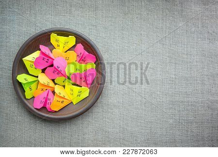 Multicolored Paper Origami Hearts With Text Love You, Kiss, Baby, Be Mine. Many Pink, Orange, Yellow