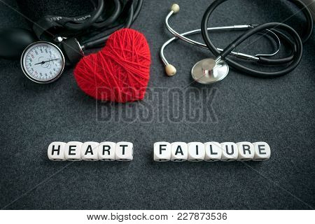 Word Heart Failure From White Cubes With Letters On Dark Background With Red Thread Heart And Tonome
