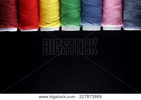Sewing Quilting Thread, Rainbow Colors. On Black Background With Place For Your Own Text.