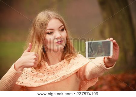 Nature Outdoor Internet Technology Concept. Cheerful Blonde Girl Taking Selfie. Young Gorgeous Lady