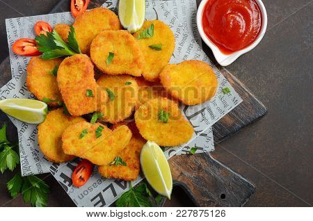 Crispy Fried Chicken Nuggets With Tomato Sauce On Dark Background Top View Flat Lay