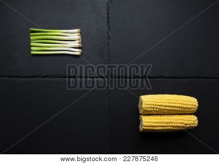 Two Vegetables, Corn, Spring Onions On Slate Platform